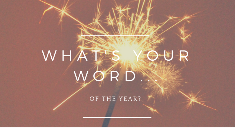 lit sparkler with the words What's Your Word of the Year?