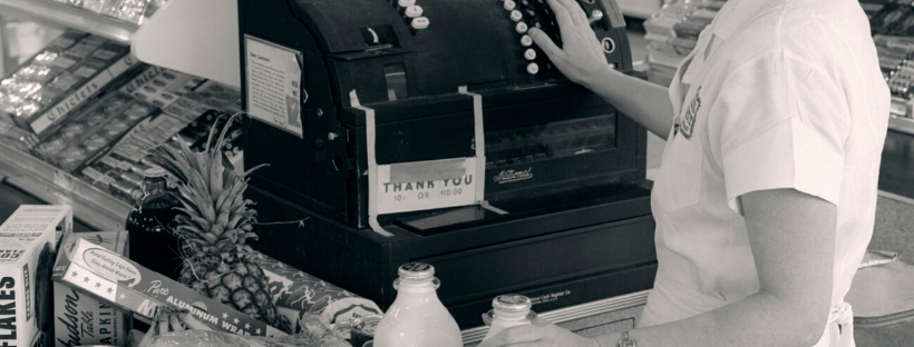 woman working an old cash register