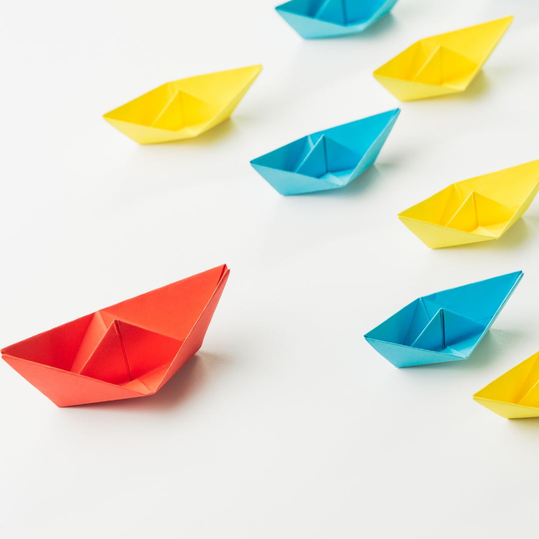 paper boats on a table
