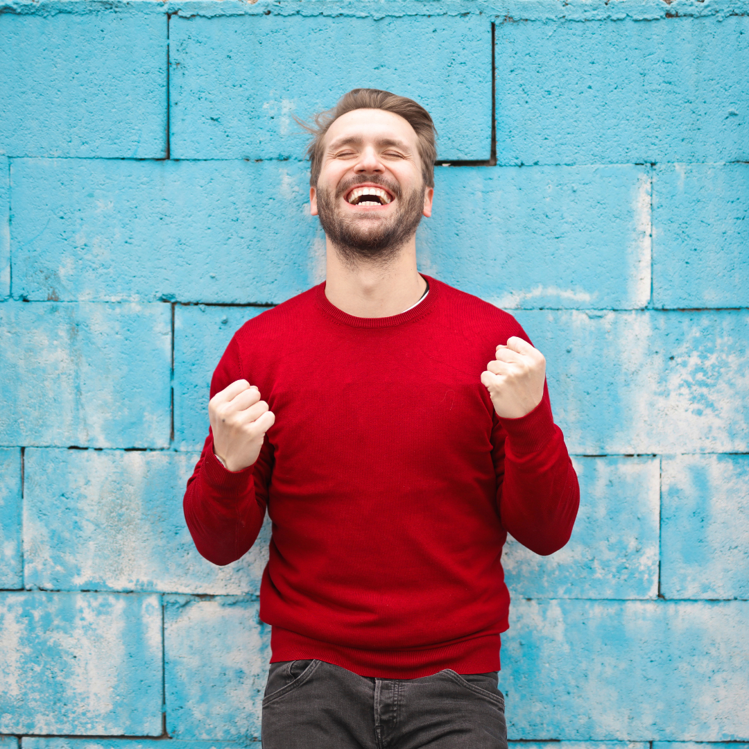a man smiling and feeling great after a virtual coaching session