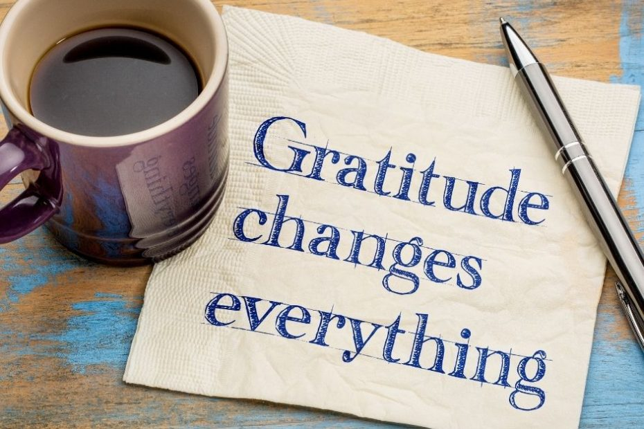 a coffee mug on a napkin that says gratitude changes everything